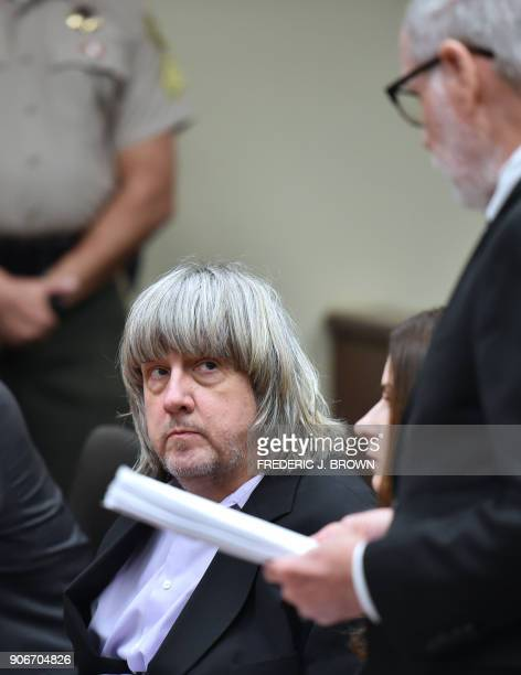David Turpin looks on as attorney David Macher speaks during his court arraignment with wife Louise in Riverside California on January 18 2018 The...