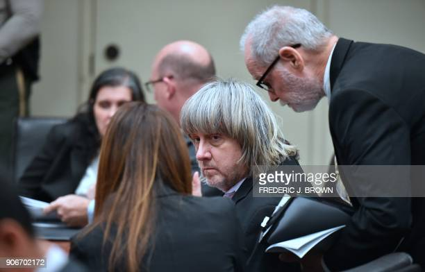 David Turpin speaks with attorneys Allison Lowe and David Macher as Louise Turpin speaks with attorney Jeff Moore during their court arraignment in...