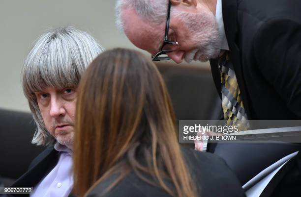 David Turpin with attorneys David Macher an Allison Lowe is seen during his court arraignment in Riverside California on January 18 2018 The...