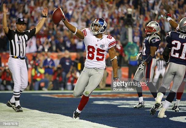David Tyree of the New York Giants celebrates his five-yard touchdown reception in the fourth quarter against the New England Patriots during Super...