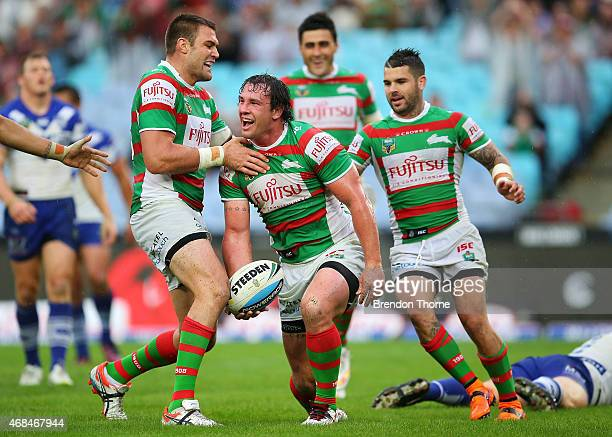 David Tyrrell of the Rabbitohs celebrates with team mates after scoing a try during the round five NRL match between the Canterbury Bulldogs and the...