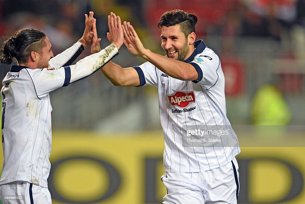 David Ulm (L) and Stephan Salger of Bielefeld celebrate their teams second goal during the Second Bundesliga match between 1. FC Kaiserslautern and Arminia Bielefeld at Fritz-Walter-Stadion on October 30, 2015 in Kaiserslautern, Germany.