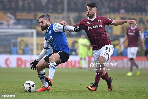 David Ulm of Bielefeld and Aias Aosman of Dresden fight for the ball during the Second Bundesliga match between DSC Arminia Bielefeld and SG Dynamo...