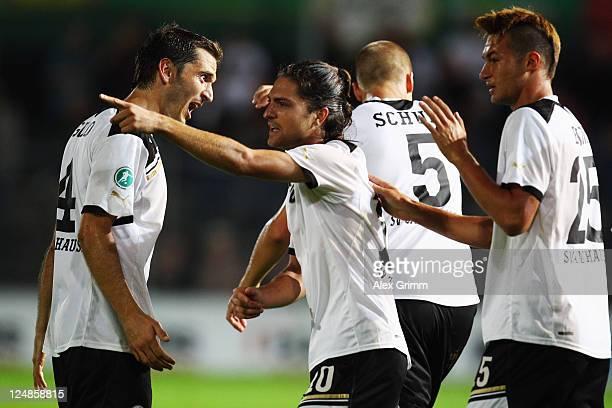 David Ulm of Sandhausen celebrates his team's first goal with team mates during the Third League match between SV Sandhausen and Jahn Regensburg at...