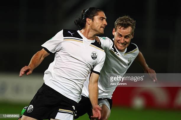 David Ulm of Sandhausen celebrates his team's first goal with team mate Soeren Halfar during the Third League match between SV Sandhausen and Jahn...