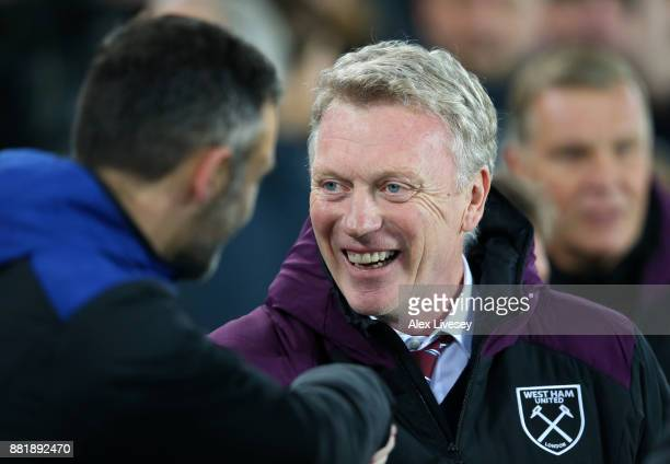 David Unsworth Caretaker Manager of Everton and David Moyes Manager of West Ham United greet each other during the Premier League match between...