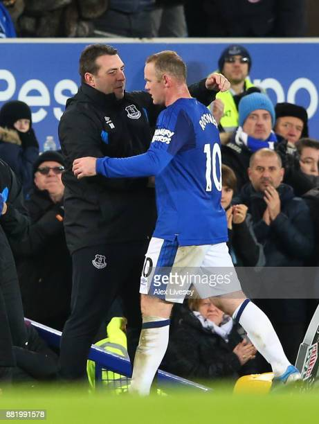 David Unsworth Caretaker Manager of Everton and Wayne Rooney of Everton embrace during the Premier League match between Everton and West Ham United...