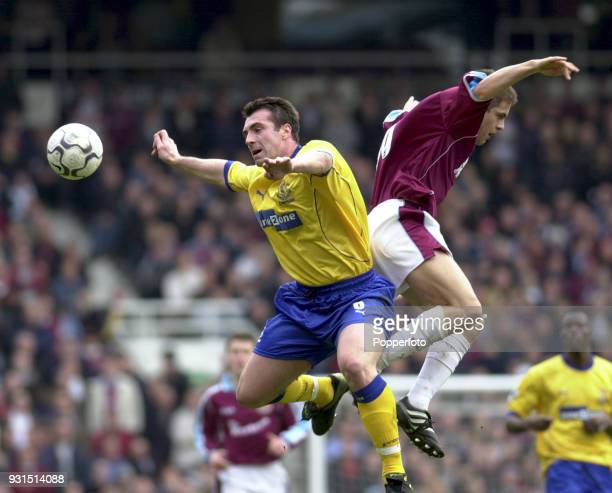 David Unsworth of Everton and Joe Cole of West Ham United in action during the FA Carling Premiership game between West Ham United and Everton at...