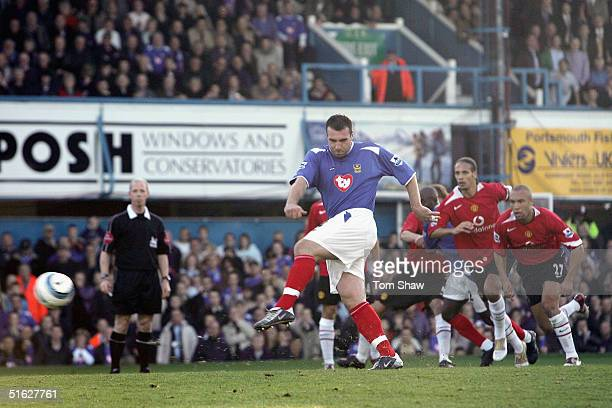 David Unsworth of Portsmouth scores from the penalty spot during the Barclays Premiership match between Portsmouth and Manchester United Fratton Park...