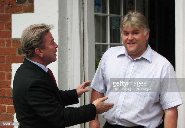 David Van Day greets David Hay owner of Galloway's restaurant on his visit to Woburn in Mid Bedfordshire the constituency where he plans to stand...