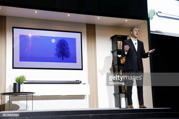 David VanderWaal vice president of marketing for LG Electronics USA speaks next to a LG W8 OLED television during the company's press conference at...