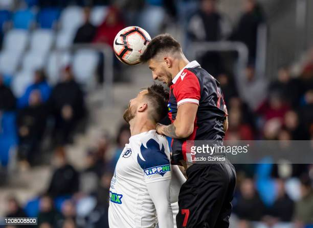 David Vanecek of Puskas Akademia FC battles for the ball in the air with Bence Batik of Budapest Honved during the Hungarian OTP Bank Liga match...