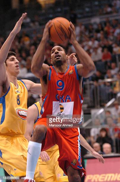 David Vanterpool of CSKA Moscow gets by Macabbi Tel Aviv's Lior Eliyahu during the NBA Europe Live Tour presented by EA Sports on October 10 2006 at...
