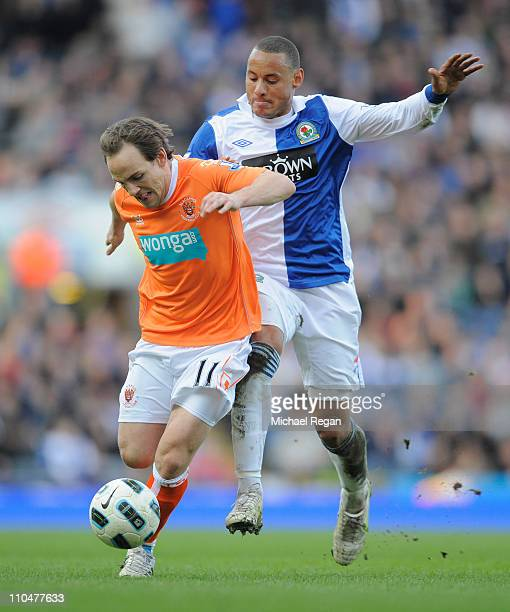 David Vaughan of Blackpool is challenged by Jermaine Jones of Blackburn during the Barclays Premier League match between Blackburn Rovers and...