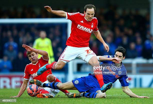David Vaughan of Nottingham Forest battles for the ball with Peter Vincenti of Rochdale during the FA Cup Third Round match between Rochdale and...
