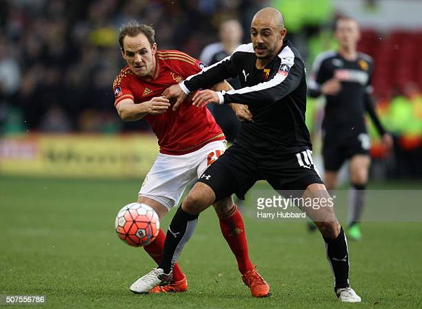 David Vaughan of Nottingham Forest battles with Nordin Amrabat of Watford during the Emirates FA Cup Fourth Round match between Nottingham Forest and...
