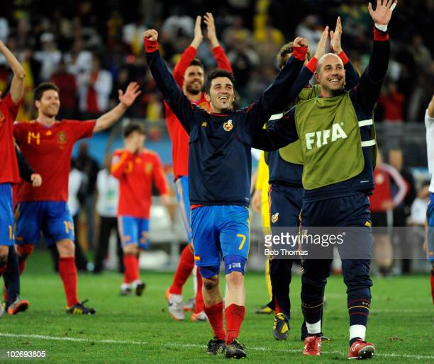 David Villa and goalkeeper Pepe Reina of Spain celebrate victory and progress to the final after the 2010 FIFA World Cup South Africa Semi Final...