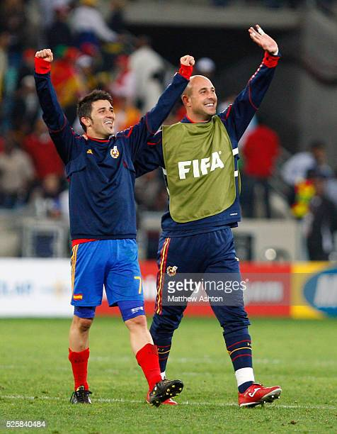 David Villa and Pepe Reina of Spain celebrate the 10 win over Germany and progress through to the final of the 2010 FIFA World Cup