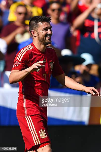 David Villa celebrates after scoring the opening goal of Spain during an international friendly match between El Salvador and Spain at FedExField on...