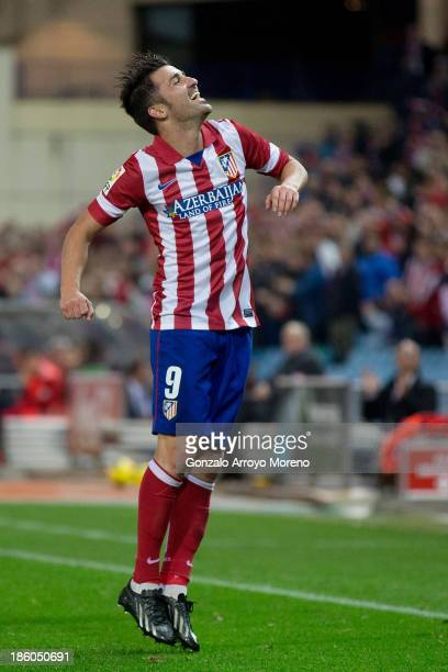 David Villa of Atletico de Madrid celebrates after scoring his team's third goal during the La Liga match between Club Atletico de Madrid and Real...
