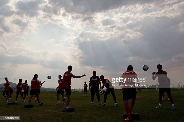 David Villa of Atletico de Madrid with teammates during his first training session with the club at the Los Angeles de San Rafael training ground on...