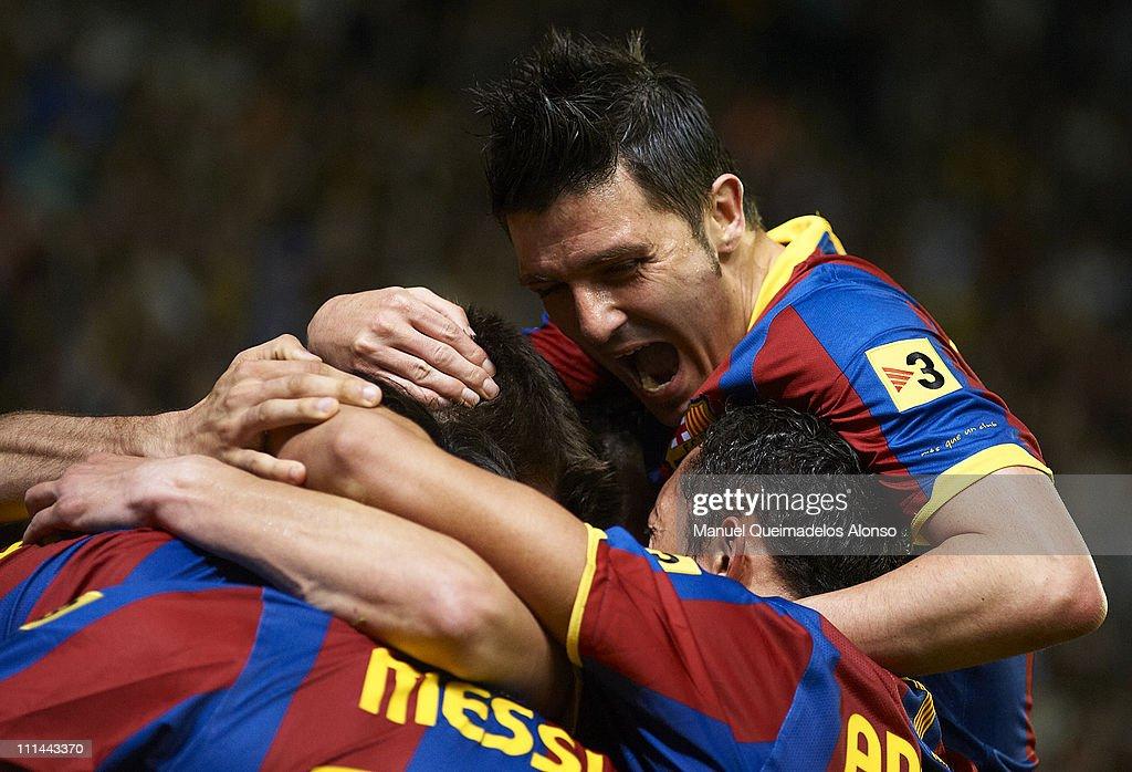 David Villa of Barcelona celebrate with his teammate during the La Liga match between Villarreal and Barcelona at El Madrigal on April 2, 2011 in Villarreal, Spain.