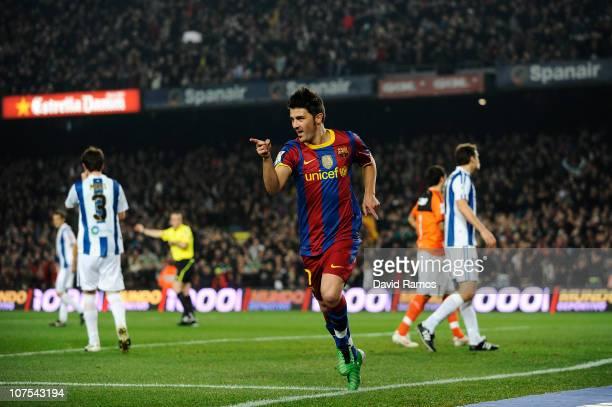 David Villa of Barcelona celebrates after scoring the opening goal during the La Liga match between Barcelona and Real Sociedad at Camp Nou Stadium...
