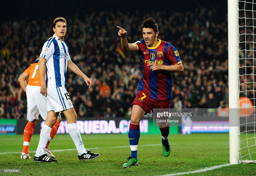 David Villa of Barcelona (R) celebrates after scoring the opening goal during the La Liga match between Barcelona and Real Sociedad at Camp Nou Stadium on December 12, 2010 in Barcelona, Spain.
