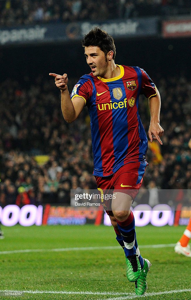 David Villa of Barcelona celebrates after scoring the opening goal during the La Liga match between Barcelona and Real Sociedad at Camp Nou Stadium on December 12, 2010 in Barcelona, Spain.