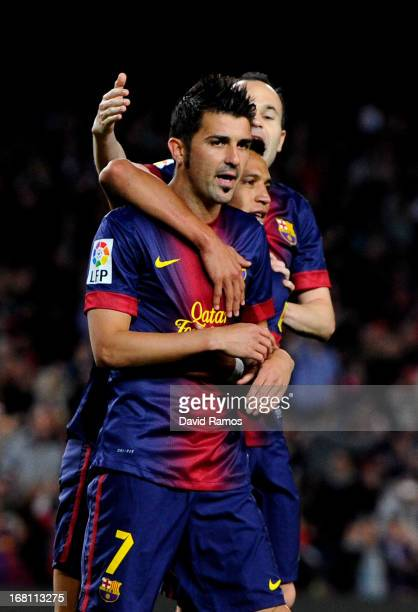 David Villa of Barcelona is congraulated by teammates Alexis Sanchez and Andres Iniesta after scoring his team's second goal during the La Liga match...
