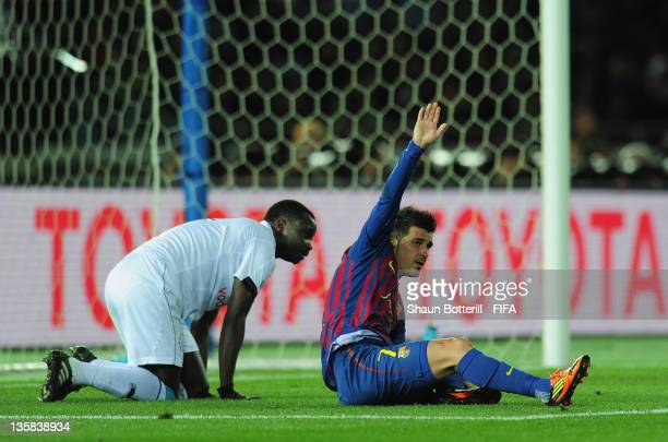 David Villa of Barcelona lies injured after breaking his leg during the FIFA Club World Cup semi final match between AlSadd Sports Club and Barcelona...