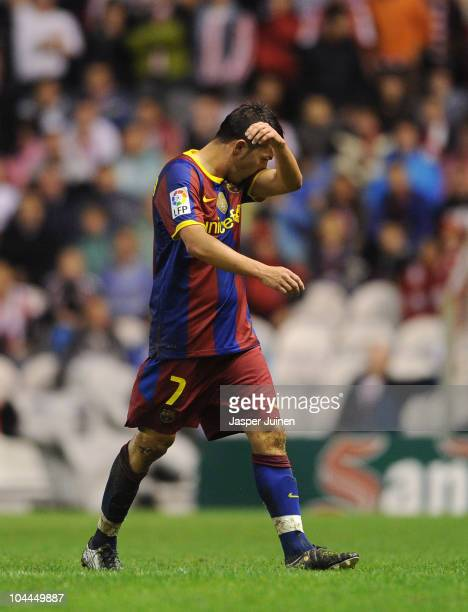 David Villa of Barcelona trudges off the pitch after receiving a red card during the La Liga match between Athletic Bilbao and Barcelona at the San...
