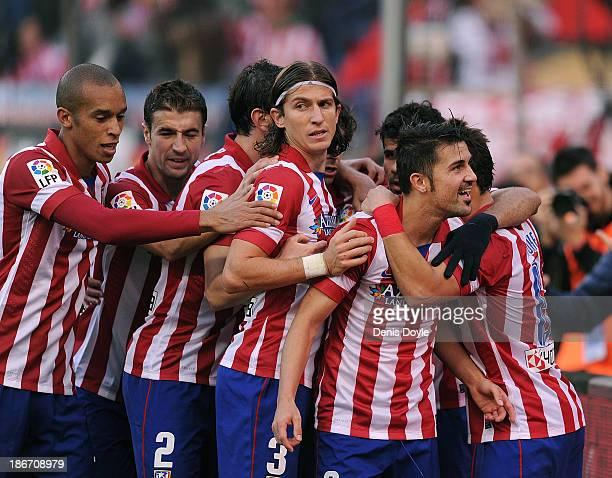 David Villa of Club Atletico de Madrid celebrates after scoring his team's opening goal during the La Liga match between Club Atletico de Madrid and...