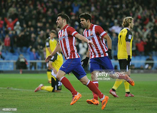 David Villa of Club Atletico de Madrid celebrates beside Diego Costa after scoring Atletico's 1st goal during the La Liga match between Club Atletico...