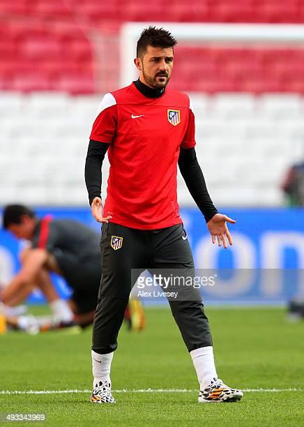 David Villa of Club Atletico de Madrid warms up during a Club Atletico de  Madrid training 047f1da1f