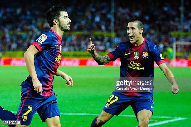 David Villa of FC Barcelona and his teammate Cristian Tello celebrates scoring their third goal during the La Liga match between Sevilla FC and FC...