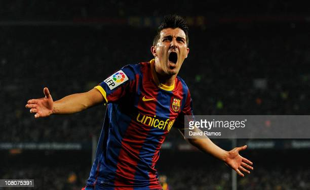 David Villa of FC Barcelona celebrates after scoring his side's second goal during the La Liga match between FC Barcelona and Malaga at Nou Camp on...