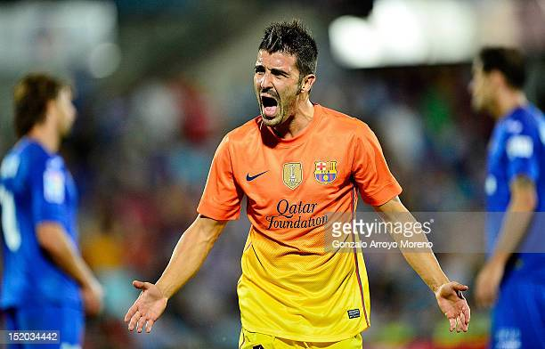David Villa of FC Barcelona celebrates scoring their fourth goal during the La Liga match between Getafe CF and FC Barcelona at Coliseum Alfonso...