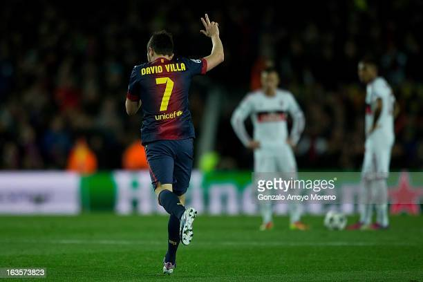 David Villa of FC Barcelona celebrates scoring their third goal during the UEFA Champions League Round of 16 second leg match between FC Barcelona...