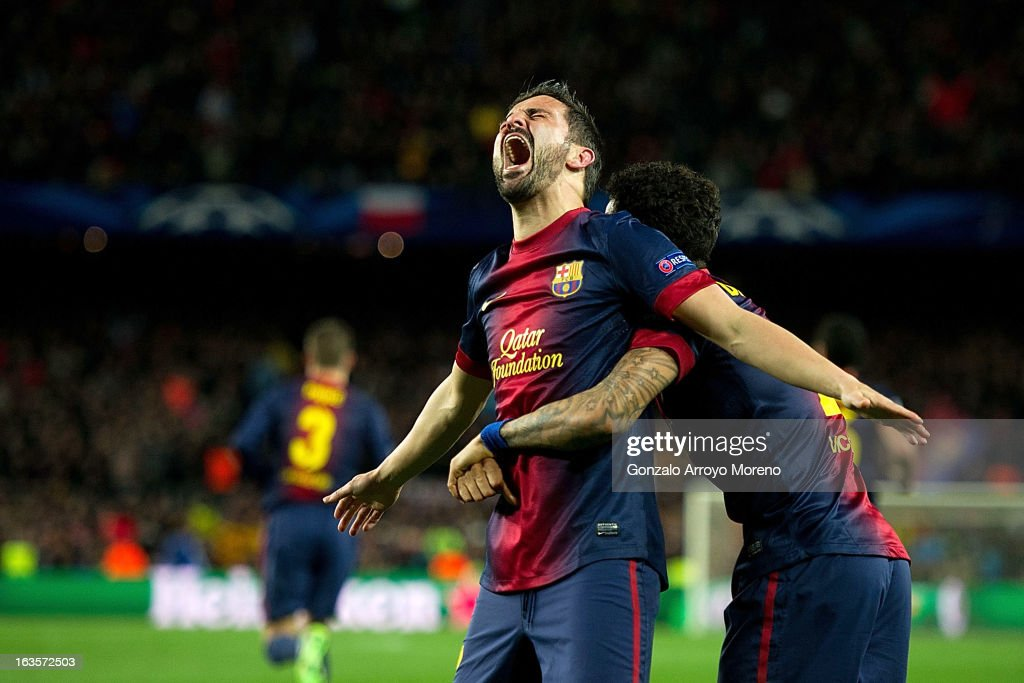 David Villa (L) of FC Barcelona celebrates scoring their third goal with teammate Dani Alves (R) during the UEFA Champions League Round of 16 second leg match between FC Barcelona and AC Milan at Camp Nou Stadium on March 12, 2013 in Barcelona, Spain.