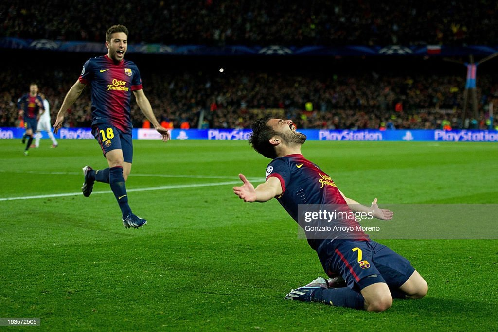 David Villa of FC Barcelona celebrates scoring their third goal with teammate Jordi Alba during the UEFA Champions League Round of 16 second leg match between FC Barcelona and AC Milan at Camp Nou Stadium on March 12, 2013 in Barcelona, Spain.