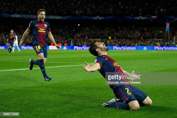David Villa of FC Barcelona celebrates scoring their third goal with teammate Jordi Alba during the UEFA Champions League Round of 16 second leg...
