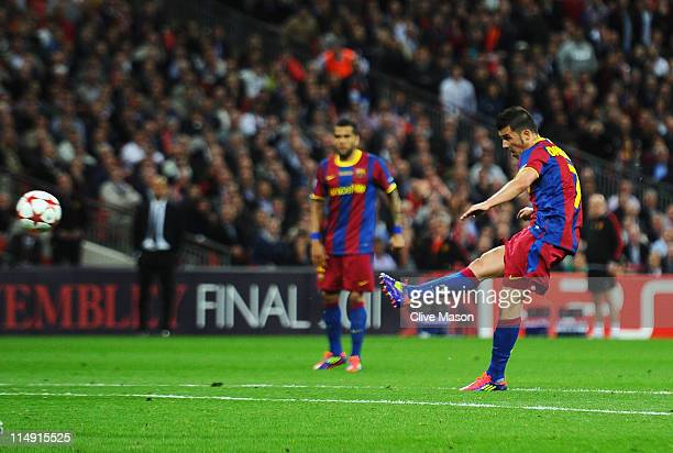 David Villa of FC Barcelona scores his teams third goal during the UEFA Champions League final between FC Barcelona and Manchester United FC at...
