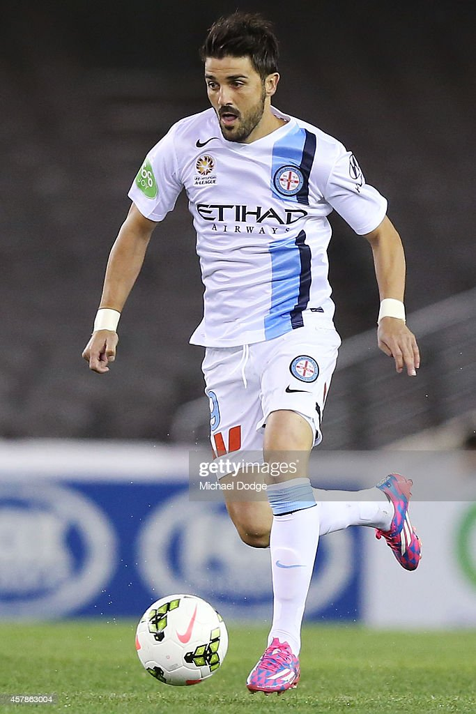 David Villa of Melbourne City runs with the ball during the round three A-League match between the Melbourne Victory and Melbourne City at Etihad Stadium on October 25, 2014 in Melbourne, Australia.