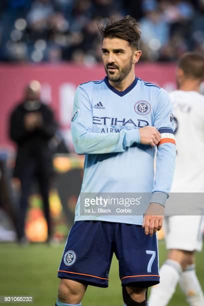David Villa of New York City adjusts his Captain armband during the MLS Regular Season Home Opener between New York City FC and LA Galaxy at Yankee...