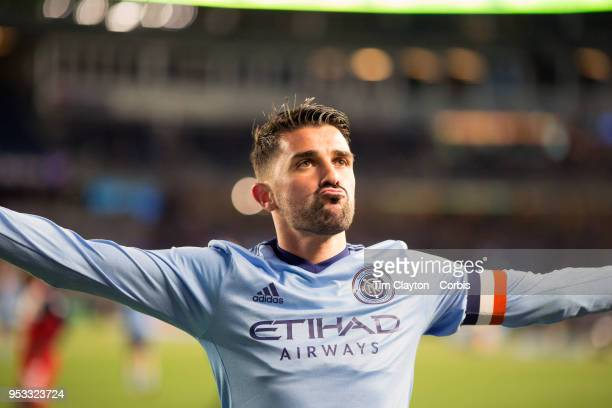 David Villa of New York City celebrates after scoring his second goal of the game in which he reached the milestone of scoring his 400th career goal...
