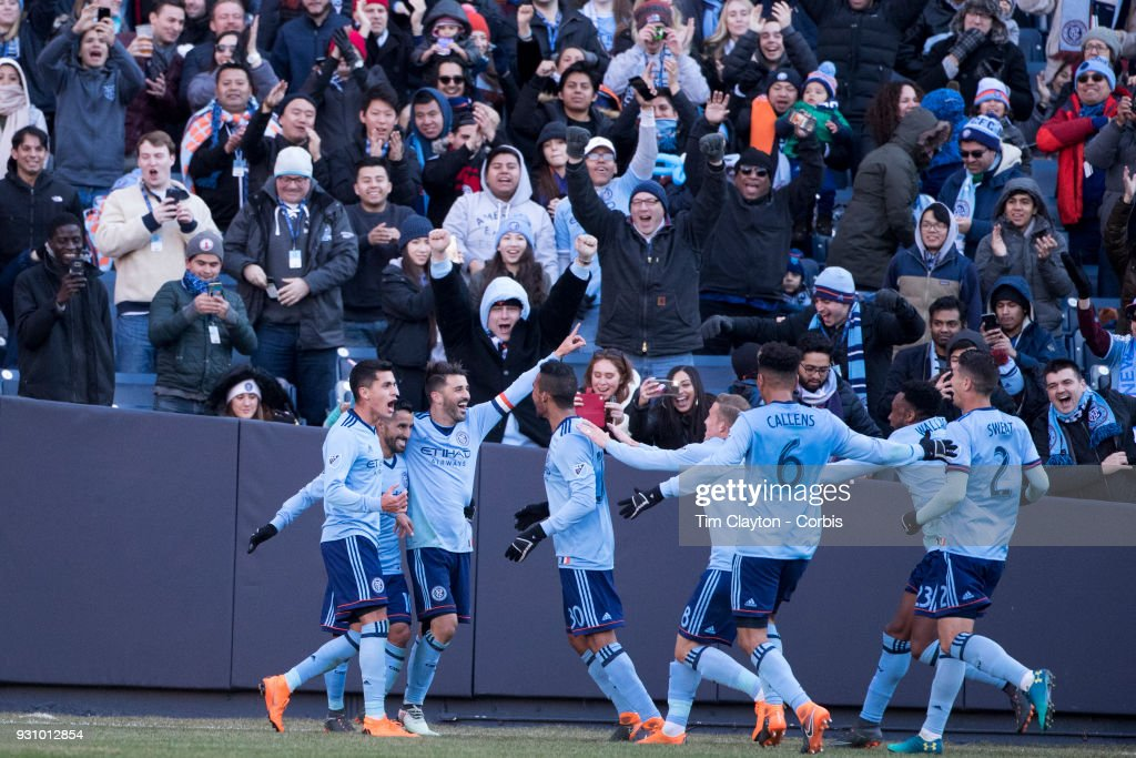 David Villa #7 of New York City celebrates with team mates after scoring his sides second goal during the New York City FC Vs LA Galaxy regular season MLS game at Yankee Stadium on March 11, 2018 in New York City.
