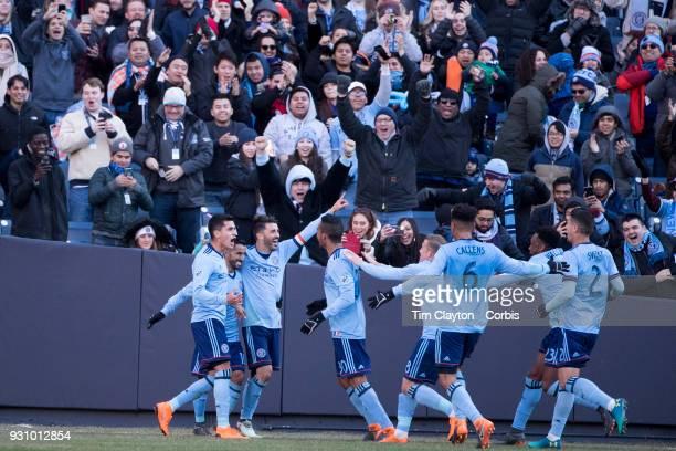 David Villa of New York City celebrates with team mates after scoring his sides second goal during the New York City FC Vs LA Galaxy regular season...