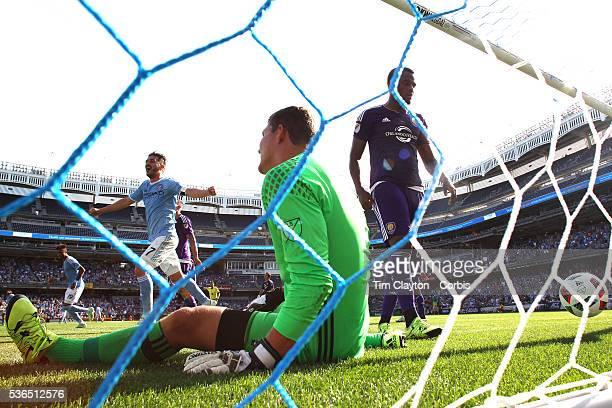 David Villa of New York City FC celebrates as goalkeeper Joseph Bendik of Orlando City FC can't stop Frederic Brillant of New York City FC header for...