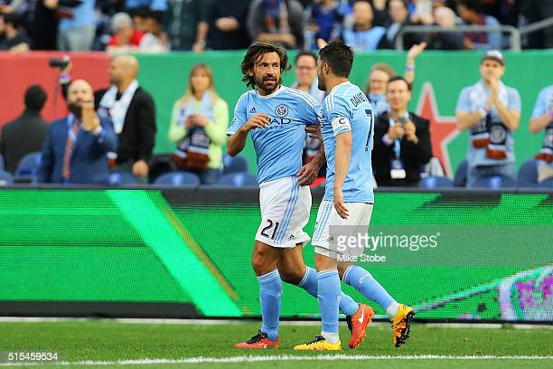 David Villa of New York City FC celebrates his first half goal with teamate Andrea Pirlo againd the Toronto FC at Yankee Stadium on March 13 2016 in...